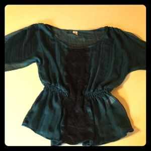 Teal and black blouse
